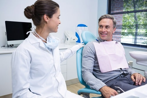 Dentist talking with patient